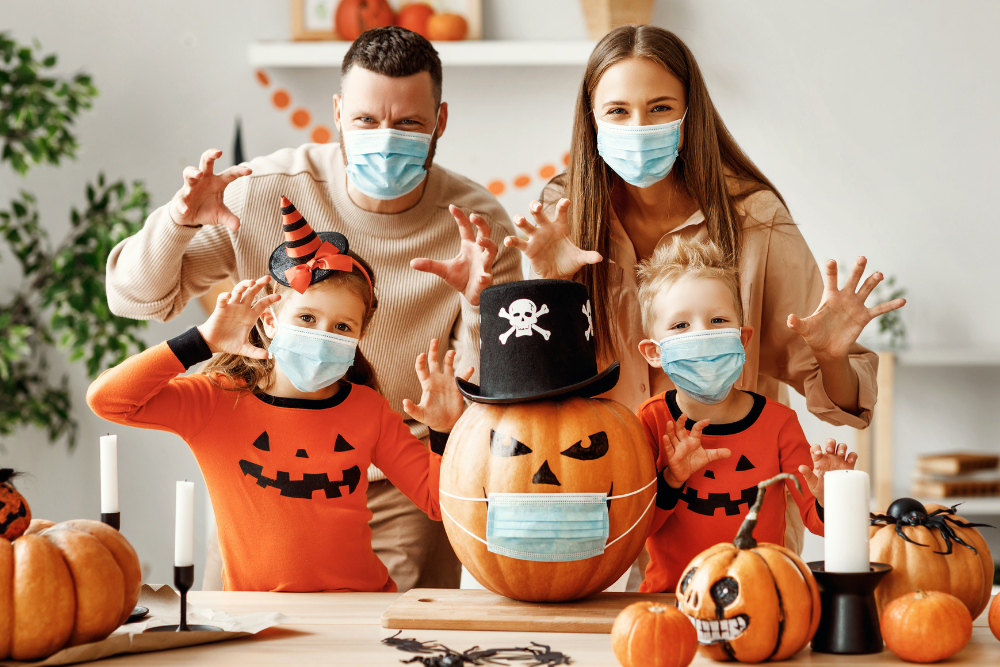 Family wearing masks ready for trick or treating during Halloween 2020 COVID