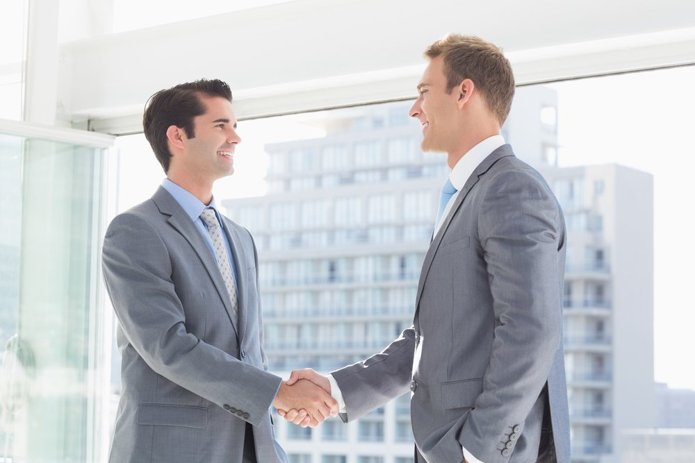 Business colleagues greeting each other in the office