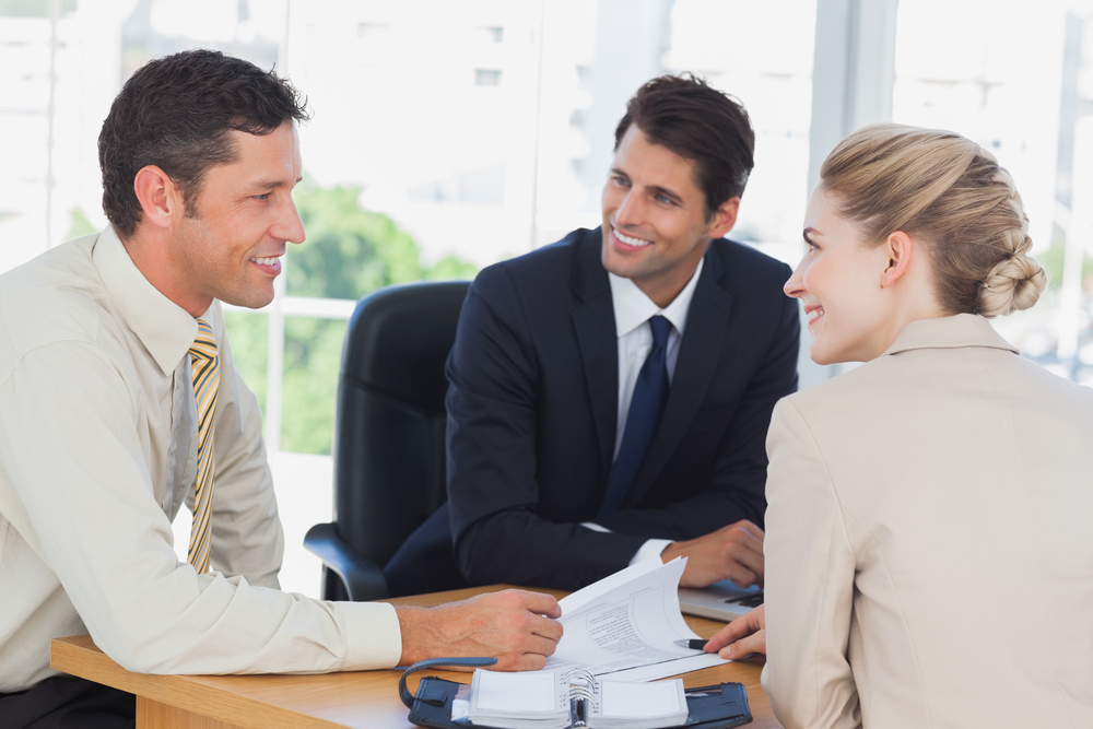 Business people smiling during a meeting in the office
