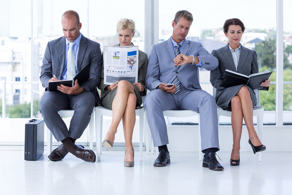 Business people waiting to be called into interview at the office-1