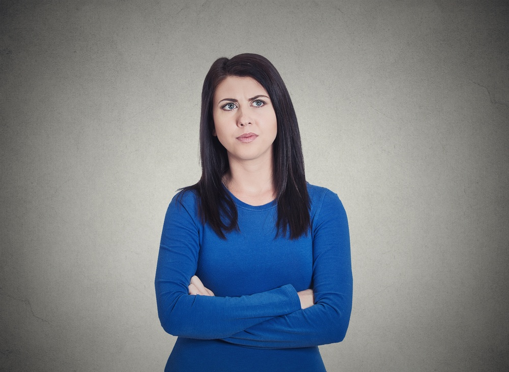 Closeup portrait grumpy annoyed, sad, unhappy, dissatisfied young woman, wife, employee, customer, isolated grey wall background. Human face expressions, emotions, reaction, attitude, perception .jpeg