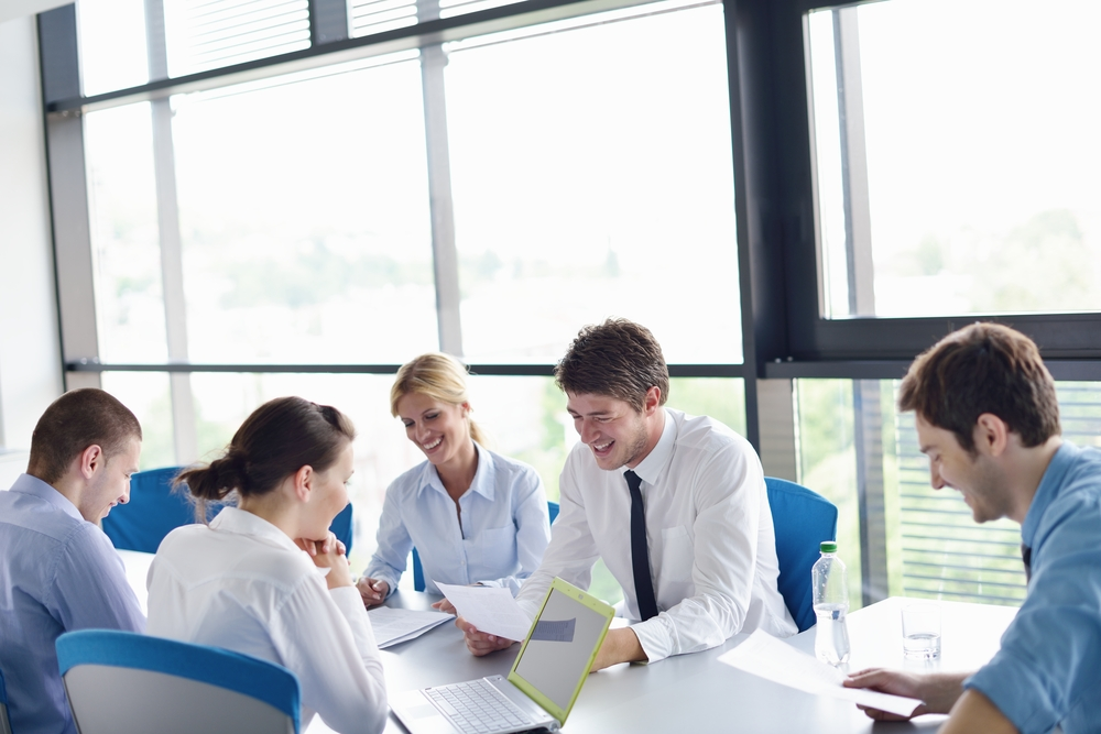 Group of happy young  business people in a meeting at office-2