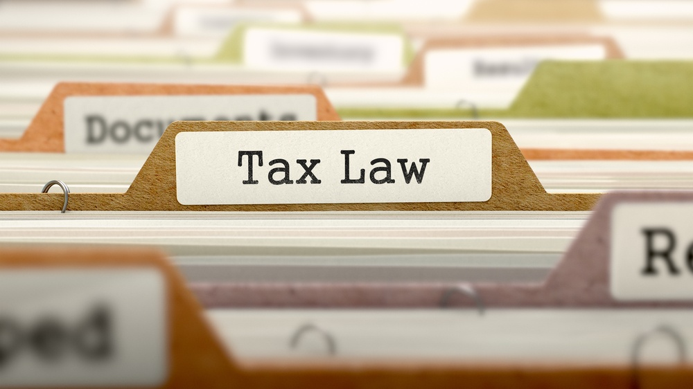 Tax Law - Folder Register Name in Directory. Colored, Blurred Image. Closeup View..jpeg