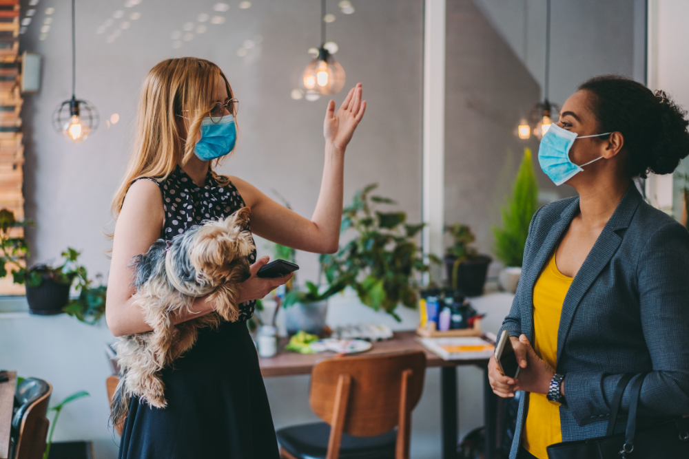 business women wearing covid masks at work
