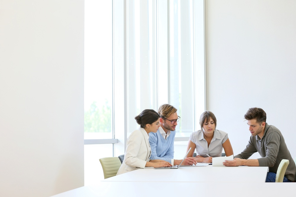 Business people meeting around table in modern space