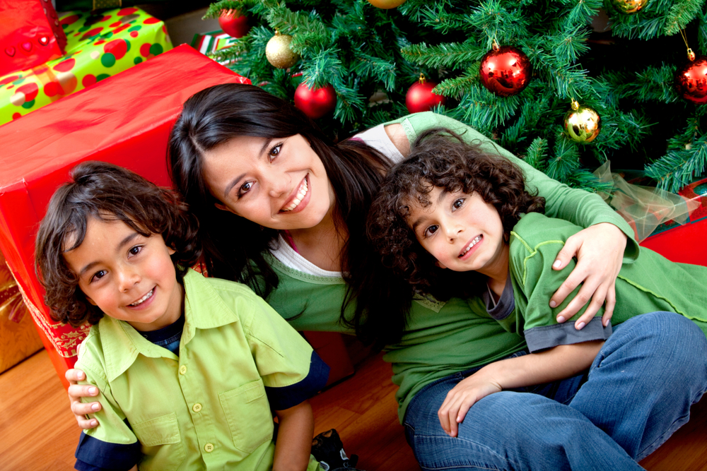 Christmas portrait of a woman with two boys smiling