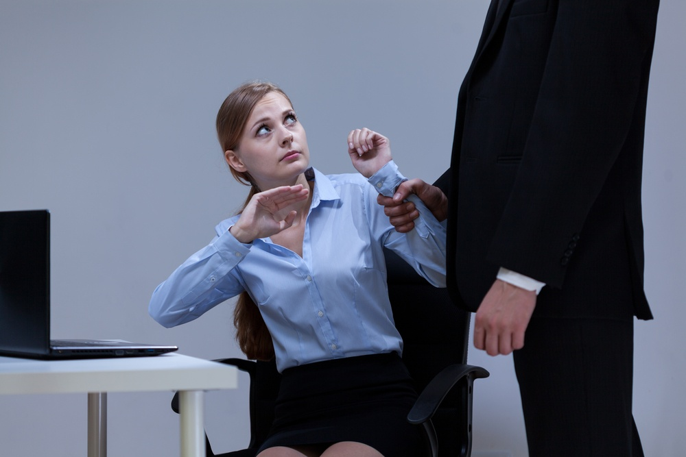 Director bullying his young attractive employee in the office