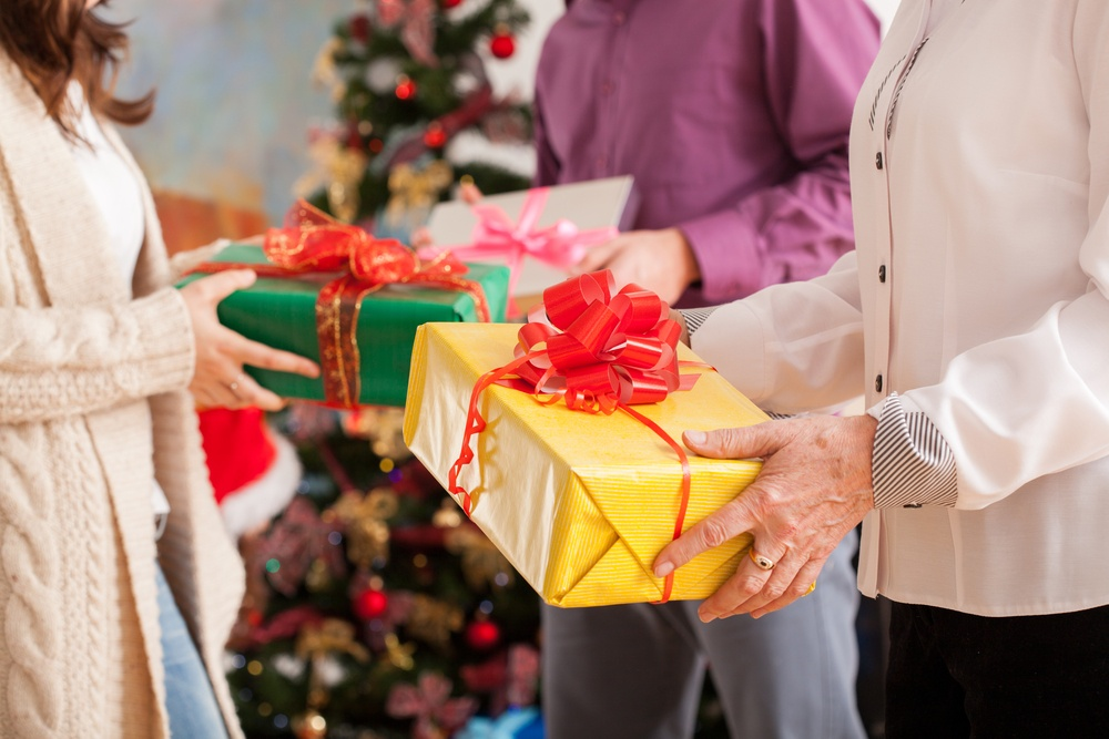 Happy family exchanging theirs Christmas gifts