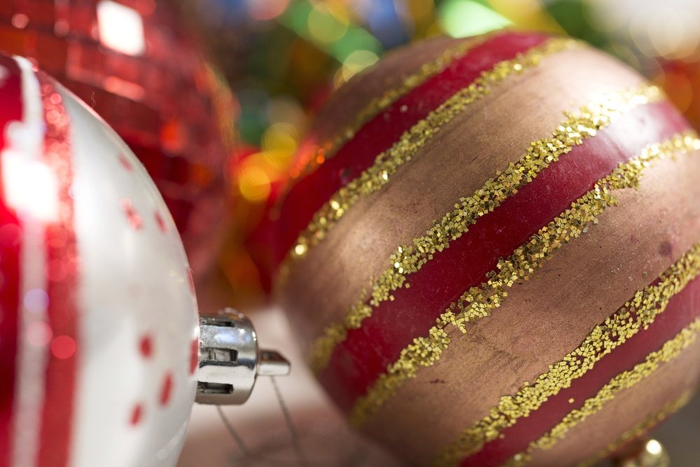 Selection of detailed Christmas bauble decorations on a light wooden surface