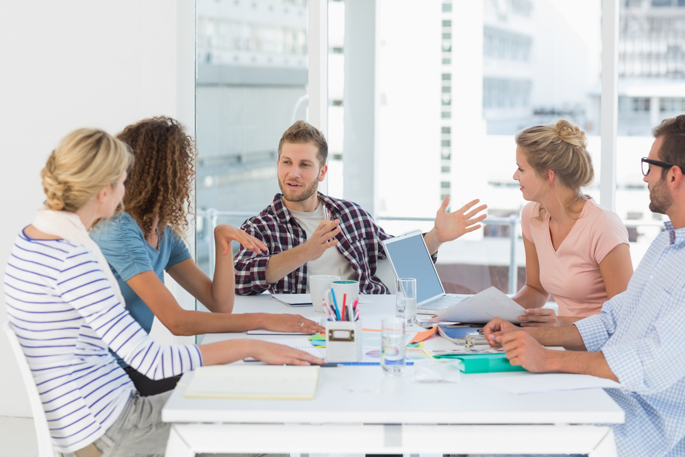 Young design team having a meeting together in creative office