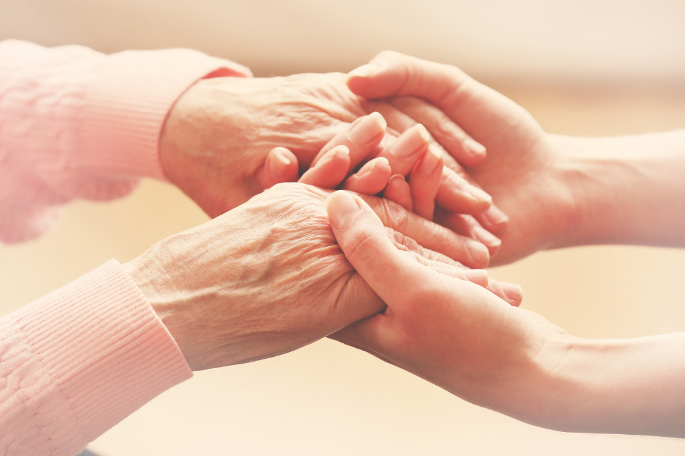 full-time working woman juggling caregiving responsibilities for elderly relative during COVID